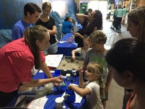 Lisa and Michael playing games with some young future scientists at the Long Island Aquarium's Meet with an Oceanographer event.